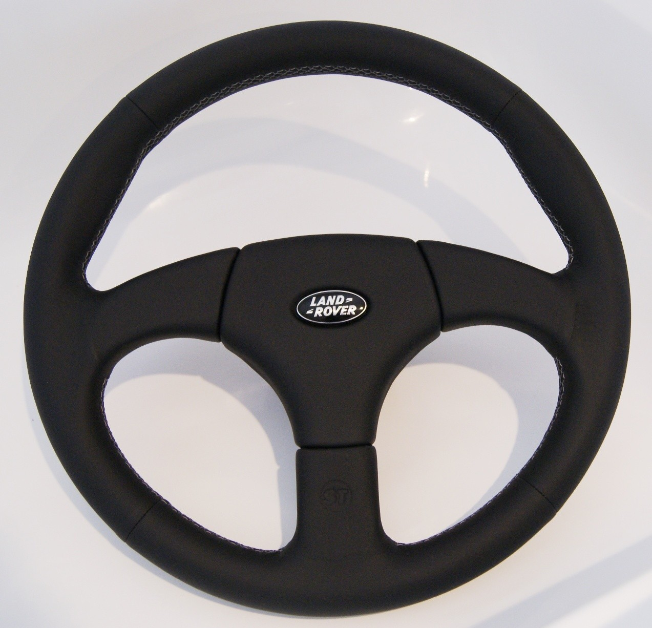 STARTECH sport steering wheel, 360mm genuine leather black, adapter, cover with Land Rover logo for all Defender up to 2016